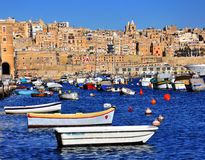 Valletta, Malta. FEBRUARY 17: Traditional maltese boats in the harbor of Valletta on February 17, 2014. Valletta is a capital and the largest city of Malta Stock Photography