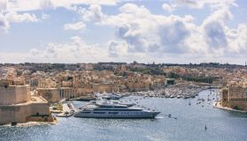 Valletta, Malta. View of Grand harbor from Upper Barrakka Gardens. Valletta, Malta. Grand harbour, luxury yachts marina view from Upper Barrakka Gardens Stock Photos