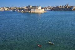 Valletta, Malta - The Grand Harbour of Malta with small boats an. D yachts, and Birgu at the background Stock Photo