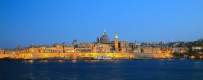 Valletta, Malta, Skyline in the evening with the dome of the Carmelite Church and the tower of St Paul`s. Valletta, Malta island. Skyline in the evening with the Royalty Free Stock Photo