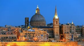 Valletta, Malta, Skyline in the evening with the dome of the Carmelite Church and the tower of St Paul`s. Valletta, Malta island, Skyline in the evening with the Royalty Free Stock Images