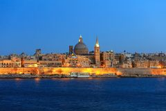 Valletta, Malta, Skyline in the evening with the dome of the Carmelite Church and the tower of St Paul`s. Valletta, Malta island, Skyline in the evening with the Royalty Free Stock Photo