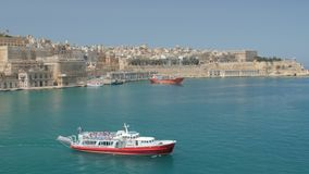 Valletta, Malta July 4, 2016 . Boats and ships in port. Valletta, Malta July 4, 2016  Boats and ships in port stock footage