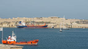 Valletta, Malta July 4, 2016 . Boats and ships in port. Valletta, Malta July 4, 2016 . Boats and cargo ships in port stock video footage