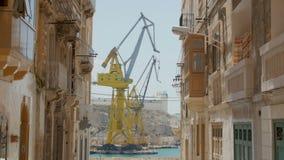 Valletta Malta - July 6 2016: Huge Ship yard crain in Malta. Valletta has a deep sea port for shipping and massive dry docks for ship yard works stock video