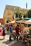 Valletta, Malta, July 2014. Lively movement of people on the main street of the city during a religious holiday. Counters of numerous souvenir dealers and royalty free stock images