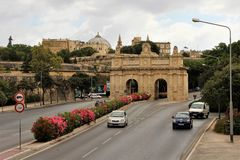 Valletta, Malta, July 2014. Triumphal arch on everywhere in the capital of the island. The feudal gates of local stone on the main thoroughfare. View of the royalty free stock images