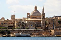 Valletta, Malta, July 2014. View of the Catholic Cathedral with a bell tower of the English-style tower. stock image