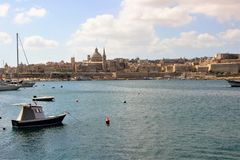 Valletta, Malta, July 2014. View of the historic part of the city with a dome of a Catholic cathedral from the side of the bay. stock images
