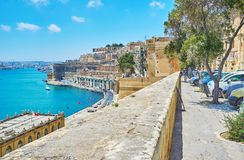 The Lvant street in Valletta, Malta. VALLETTA, MALTA - JUNE 17, 2018: The Lvant street stretches along the medieval fortress wall and overlooks the coast of Stock Photography