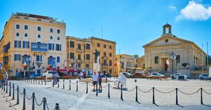 The top landmarks of Castille Place, Valletta, Malta. VALLETTA, MALTA - JUNE 17, 2018: Panorama of Castille Place with statue of George Borg Olivier in the Royalty Free Stock Images