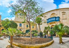 Panorama of garden in Grandmaster`s Palace Court, Valletta, Malt. VALLETTA, MALTA - JUNE 17, 2018: Panorama of the scenic green garden in Prince Alfred`s Stock Images