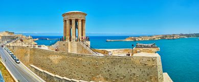 Panorama of the Siege Bell War Memorial, Valletta, Malta. VALLETTA, MALTA - JUNE 17, 2018: Panorama of Siege Bell War Memorial with rotunda, Tomb of Unknown Royalty Free Stock Photography