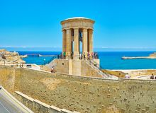 Rotunda of Siege Bell War Memorial, Valletta, Malta. VALLETTA, MALTA - JUNE 17, 2018: The stone rotunda with bronze bell of Siege Bell War Memorial, located on Stock Image