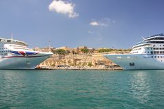Valletta, Malta - may 2018: Two big cruise ships anchored in port in sunny day royalty free stock photo
