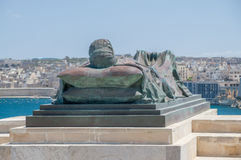 Valletta, Malta - May 9, 2017: War Siege Memorial next to Siege Bell War Memorial. Royalty Free Stock Images