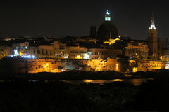 Valletta, Malta night view from Sliema. View of Dome of Roman Catholic Basilica of Our Lady of Mount Carmele and St Paul's Pro-Cathedral tower Royalty Free Stock Images