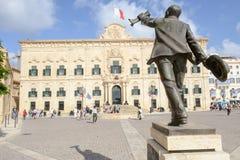 Auberge de Castille. The Prime Minister office. Valletta, Malta. Valletta, Malta - 31 October 2017: people walking in front of Auberge de Castille. The Prime Stock Photos