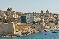 View of a coast and downtown of Valletta in Malta. VALLETTA, MALTA - OCTOBER 30, 2017: View of an old architecture, coast and downtown area of Valletta in Malta Royalty Free Stock Photography