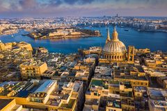 Valletta, Malta - Our Lady of Mount Carmel Church and Manoel Island. At sunrise Stock Photography