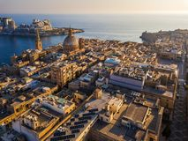 Valletta, Malta - Our Lady of Mount Carmel church and St.Paul`s Cathedral from above with Sliema at background. At sunrise Stock Image