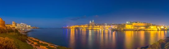 Valletta, Malta - Panoramic skyline view of the ancient city of Valletta. And Sliema shot from Manoel Island by night Royalty Free Stock Images