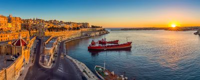 Valletta, Malta - Panoramic skyline view of Valletta and the Grand Harbor with beautiful sunrise Stock Photos