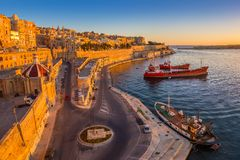Valletta, Malta - Panoramic skyline view of Valletta and the Grand Harbor with beautiful sunrise Royalty Free Stock Photography