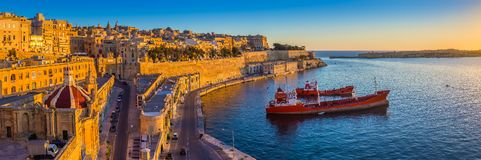 Valletta, Malta - Panoramic skyline view of Valletta and the Grand Harbour at sunrise. Valletta, Malta - Panoramic skyline view of Valletta and the Grand Harbor Stock Image