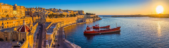 Valletta, Malta - Panoramic skyline view of Valletta at sunrise. Valletta, Malta - Panoramic skyline view of Valletta and the Grand Harbor with beautiful sunrise Royalty Free Stock Image