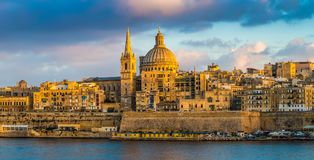Valletta, Malta - Panoramic view of golden hour at the famous St.Paul`s Cathedral. And the city of Valletta Stock Photo