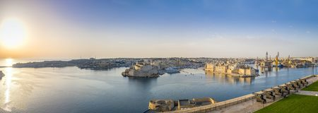 Valletta, Malta - Panoramic view over the Grand Harbour with Saluting Battery cannons. At sunrise Stock Photos