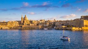Valletta, Malta - Panoramic view of Saint Paul`s Cathedral. And the ancient walls of Valletta with sail boat in the morning Stock Photos