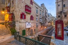 Free Valletta, Malta - Red Vintage British Telephone Box And Footbridge And Traditional Red Balconies In The Ancient City Of Valletta Stock Image - 89502861