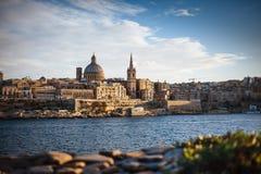 Valletta, Malta: skyline from Marsans Harbour at sunset royalty free stock images