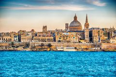 Valletta, Malta: skyline from Marsans Harbour at sunset. The cathedral Royalty Free Stock Images