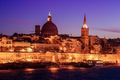 Valletta, Malta: skyline from Marsans Harbour at sunset. The cathedral Stock Photo