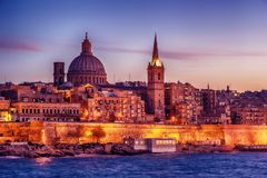 Valletta, Malta: skyline from Marsans Harbour at sunset. The cathedral Royalty Free Stock Photography