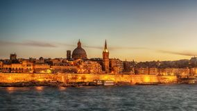 Valletta, Malta: skyline from Marsans Harbour at sunset. The cathedral Royalty Free Stock Image
