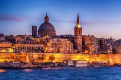 Valletta, Malta: skyline from Marsans Harbour at sunset. The cathedral Royalty Free Stock Photo