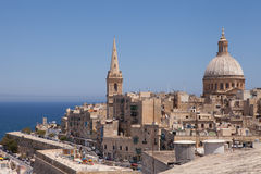 Valletta, Malta. St Paul`s Pro-Cathedral tower and the dome of the Carmelite Church look out over Marsamxett Harbour Royalty Free Stock Photo