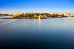 Valletta, Malta - Summer sunrise view with Manoel island, Valletta and Sliema with sailing boats. And clear blue sky Royalty Free Stock Image