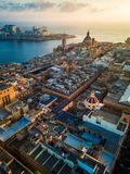 Valletta, Malta - Sunrise above Valletta with Our Lady of Mount Carmel church and St.Paul`s Cathedral. With Sliema at background Royalty Free Stock Photography