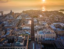 Valletta, Malta - Sunrise and the ancient city of Valletta from above with Triq Ir-Repubblika. The narrow high street of Valletta Royalty Free Stock Photography