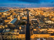Valletta, Malta - Sunrise at the ancient city of Valletta from above with Triq Ir-Repubblika. The narrow high street of Valletta Royalty Free Stock Photo