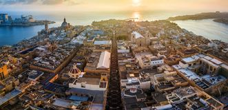 Valletta, Malta - Sunrise and the ancient city of Valletta from above with Triq Ir-Repubblika, the narrow high street. Of Valletta Stock Photo