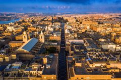 Valletta, Malta - Sunrise at the ancient city of Valletta from above. With Triq Ir-Repubblika, the narrow high street of Valletta Royalty Free Stock Photography