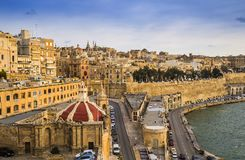 Valletta, Malta - Sunrise at the Grand Harbour of Malta with the. Ancient walls of Valletta Royalty Free Stock Photos