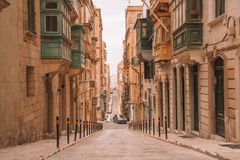 Valletta, Malta - The traditional houses. Narrow streets and walls of Valletta, the capital city of Malta on an early summer morning before sunrise Royalty Free Stock Images