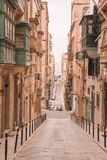 Valletta, Malta - The traditional houses. Narrow streets and walls of Valletta, the capital city of Malta on an early summer morning before sunrise Stock Image